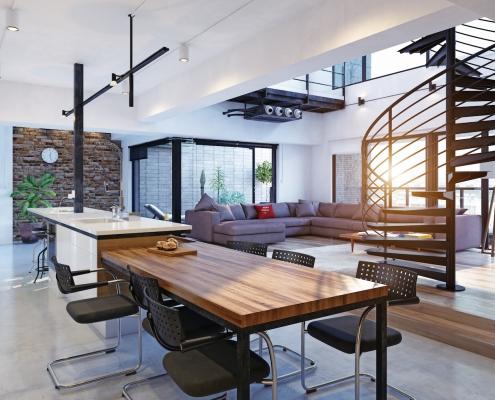 Escalier hélicoïdal en acier noir dans un loft